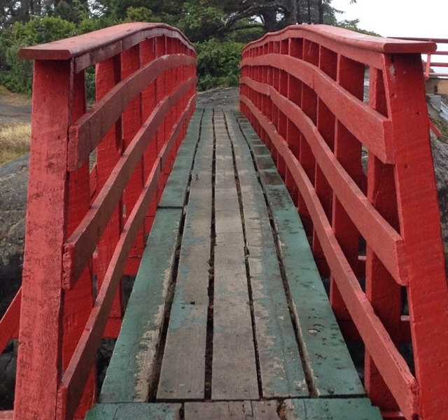 An old red and green footbridge connecting Point No Point to Vancouver Island